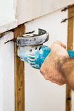 Cutting Insulation with Grinder Stock Photos