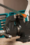 Cutting iron with saw on vice tool, clamping device. Stock Image