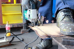 The cutting jigsaw. The process of cutting sheet metal with a jigsaw Royalty Free Stock Photography