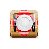 Cutting kitchen wooden board with plate, knife and fork on napki Stock Photos