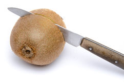 Cutting a kiwi in half Royalty Free Stock Photography