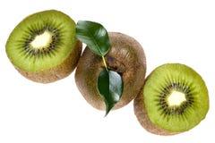 Cutting kiwi on white Stock Photos