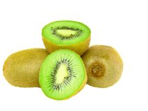 Cutting kiwi on white. Isolated Stock Photo