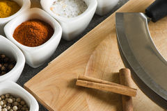 Cutting knife with pots of spices Royalty Free Stock Photo