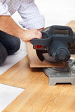 Cutting laminate flooring pieces Stock Image