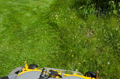 Cutting the lawn Royalty Free Stock Photography