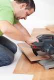 Cutting and laying laminate flooring planks Stock Photography