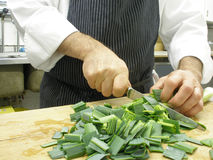 Cutting leeks Royalty Free Stock Photos