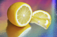 Cutting a lemon. On a colorful background Royalty Free Stock Photography
