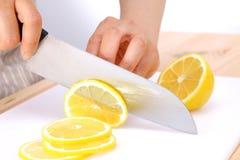 Cutting lemon Royalty Free Stock Images