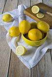 Cutting lemons Royalty Free Stock Images