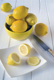 Cutting lemons Stock Image