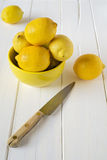 Cutting lemons Stock Images