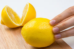 Cutting Lemons on Wooden Cutting Board Royalty Free Stock Photos
