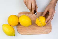 Cutting Lemons on Wooden Cutting Board Stock Image
