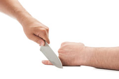 Cutting the little finger with a knife royalty free stock photos