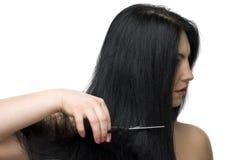 Cutting long hair royalty free stock image