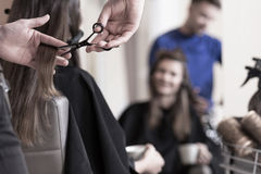 Cutting long hair Royalty Free Stock Images