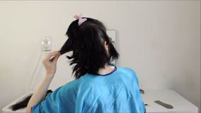 Cutting long hair off stock video