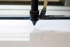Cutting machine carving patterns. On the plastic plate royalty free stock photo