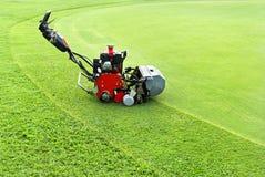 Cutting machine  on golf green Royalty Free Stock Photo