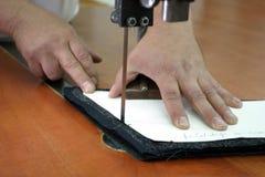 Cutting machine and hands. Closeup detail of a hands operating a cutting machine pressure foot stock photos