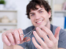 Cutting male nails Stock Photo