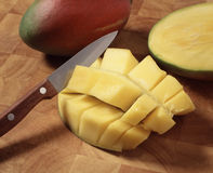 Cutting the mango Royalty Free Stock Image