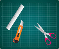 Cutting Mat With Box Cutter, Ruler and Scissors Royalty Free Stock Photography