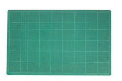Cutting mat. Green cutting mat for isolated Royalty Free Stock Photography