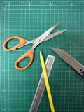 Cutting mat. Office equipment available tools stock photo