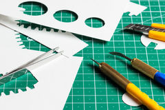 Cutting mat. With paper and tools Stock Image