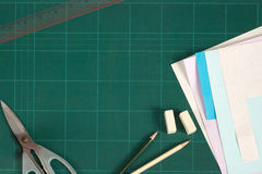 Cutting mat and stationery. Green cutting mat and stationery royalty free stock photos