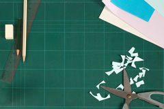 Cutting mat and stationery. Green cutting mat and stationery Stock Photo