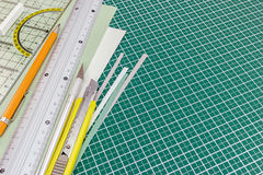 Cutting mat with utility knife, mechanical pencil, metal ruler a Royalty Free Stock Photos