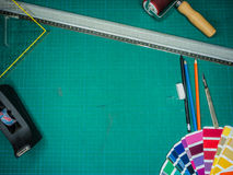 Cutting mat with various stationary tools, shot from above Royalty Free Stock Image