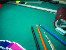 Cutting mat with various stationary tools, shot from above Stock Photography