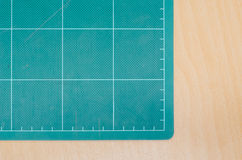 Cutting mat on wooden table, stationary. Office stock illustration