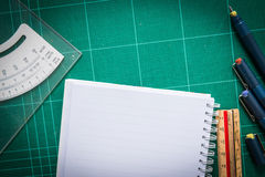 Cutting mats , paper , Pen drawings , adjust angle tool , scale Stock Image