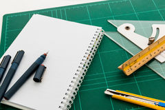 Cutting mats , Pen drawings , adjust angle tool , scale ruler , Stock Photography