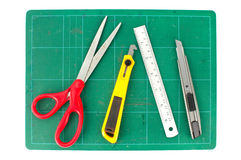 Cutting mats with scissors ruler and cuter on white background Stock Photos