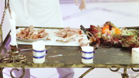 Cutting meat at banquet stock footage