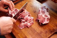 Cutting meat Royalty Free Stock Images
