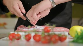 Cutting meat stock video footage