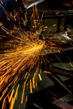 Cutting metal with angle grinder. stock photo