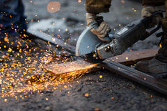 Cutting metal with angle grinder. Cutting rectangular metal pipe with angle grinder Royalty Free Stock Photos