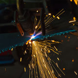 Cutting metal with a gas torch Stock Photos