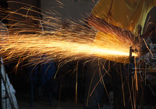 Cutting metal with grinder Stock Photo