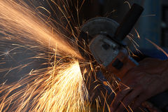Cutting metal with grinder Royalty Free Stock Photo