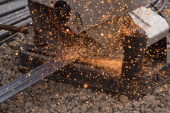 Cutting metal with grinder. Sparks while grinding iron Royalty Free Stock Images